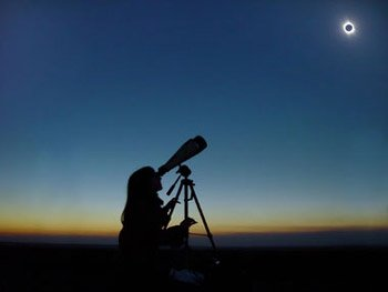 Girl viewing Solar Eclipse using Astronomy Binocular